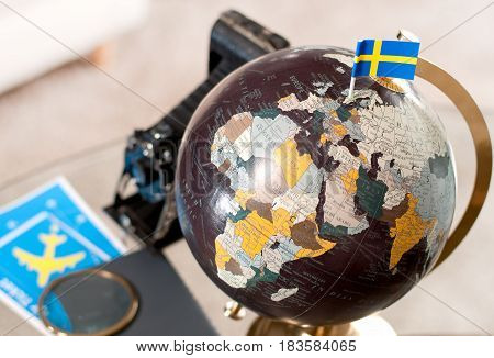 Air Ticket And Swedish Flag On Globe