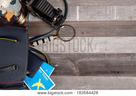 Air Ticket, Globe  And Bag On Wood Background