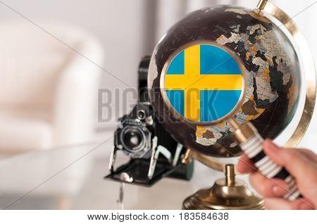 Swedish Flag On Globe Under Magnifying