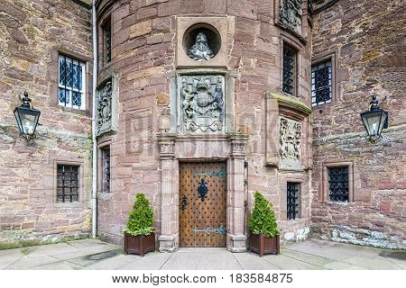 Glamis, United Kingdom - August 17, 2014: The entrance of Glamis Castle. This castle is open to the public and was the childhood home of Queen Elizabeth The Queen Mother, wife of King George VI