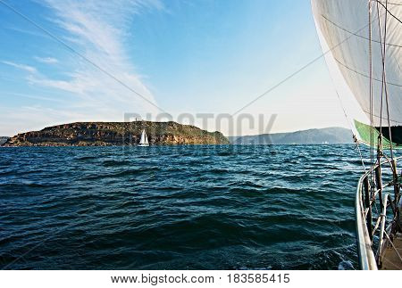 Cruising Sailing Yacht under sail at sea heading to the safe harbour of Broken Bay New South Wales Australia.