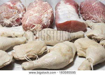 Preparation raw meat for smoking. Pork neck meat and bacon. Preparation of meat for smoking chicken. Meat prepared for smoking