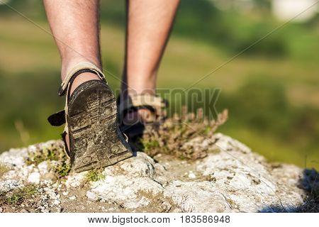 Successful Hiker Legs Walking On Mountain Peak Rock. Adventure And Exercising In Summer Nature.