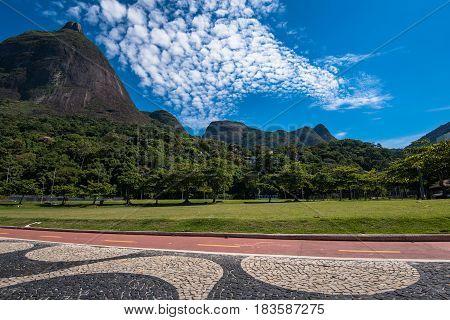 Famous Copacabana Style Mosaic Sidewalk and Beautiful Mountain Landscape With Pedra da Gavea in Rio de Janeiro, Brazil