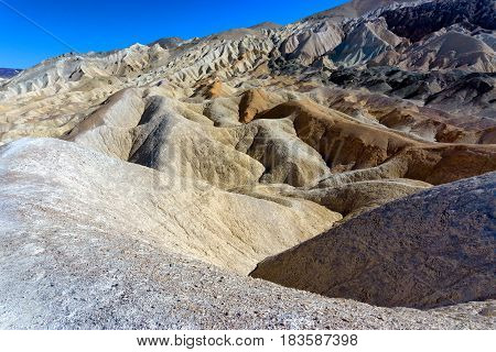 Dry waterless view of Twenty Mule Team Canyon in Death Valley National Park in California