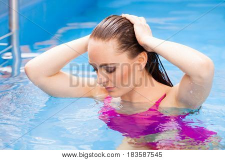 Woman Enjoying The Water In Swimming Pool