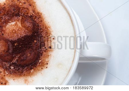 Latte Overhead Close Up On White Table