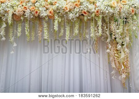 Beautiful background of flowers and white textiles for a wedding scene