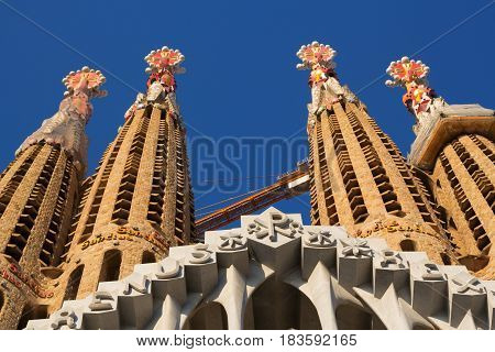 Barcelona Spain - 26 March 2017: View on the towers of Sagrada Familia. Sagrada Familia is very popular touristic place in Barcelona.