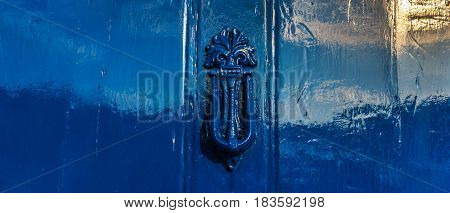 Blue Door With Brass Knocker In Decorative Shape, Beautiful Home Entrance, Vintage Decor