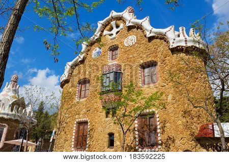 Barcelona Spain - 26 March 2017: Gatehouse at the main entrance to Park Guel designed by Antonio Gaudi which were originally designed as the caretaker's house
