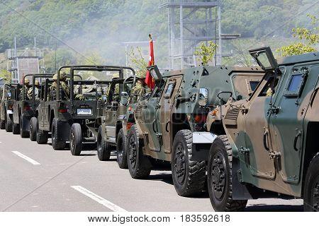Kagawa, Japan - April 23 2017: Japanese armored vehicle departs with Japanese soldier at the Zentuji, Kagawa military base