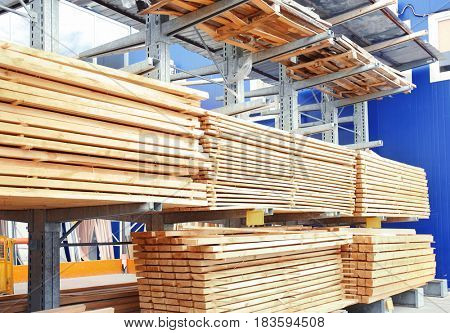 Many wooden planks in hardware store