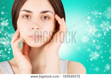 winter present - beauty skin concept portrait of brunette model
