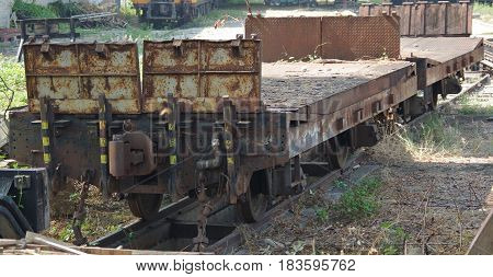 Flatbed railway carriages on a rail siding.