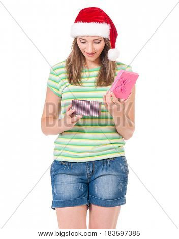 Surprised Christmas girl wearing Santa hat holding gift box, isolated on white background.