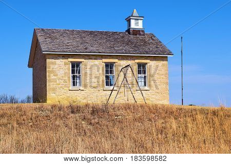 Fox Creek Schoolhouse which is a historical schoolhouse built during the 1880s taken at the Tallgrass Prairie on the Kansas Plains