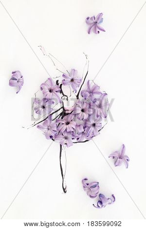 Hand drawn ballerina dancer wearing dress made of natural hyacinth flowers and posing on a tiptoe isolated over white. Fashion illustration