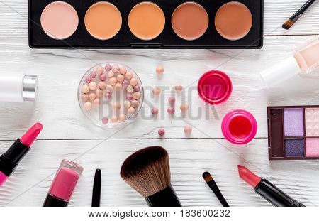 decorative cosmetics set on white woman desk background top view