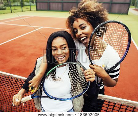 young pretty girlfriends hanging on tennis court, fashion stylish dressed swag, best friends happy smiling together lifestyle, people sport concept close up
