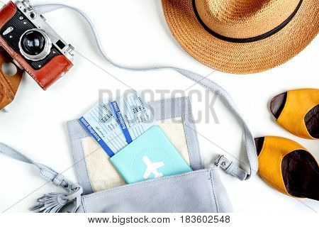 tourist lifestyle with clothes, passport and tickets on white table background top view