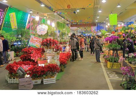 TAIPEI TAIWAN - DECEMBER 3, 2016: Unidentified people visit Jianguo weekend Flower Market. Jianguo Flower Market is a major flower market where locals can buy fresh flowers bushes and house plants.