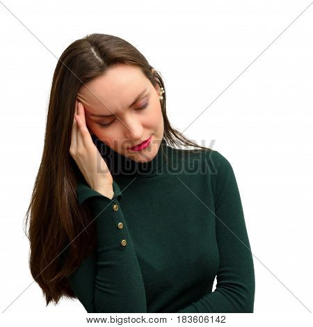Young girl with headache holds head with his hand. the pain in his temples. migraine pressure.