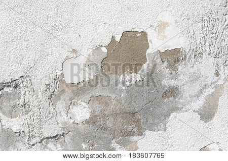 the old house wall with cracked plaster