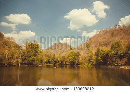 Lake Near Mountain And Tree With Sky And Cloud In Vintage Tone.