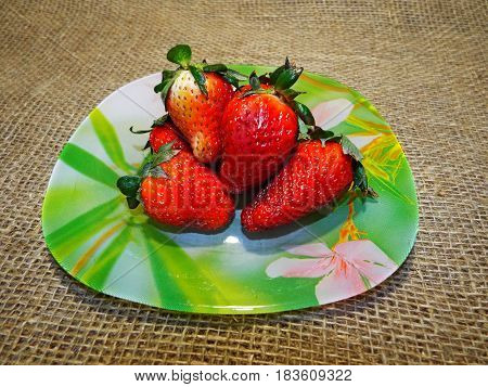 A handful of delicious and juicy strawberries exudes alluring aroma