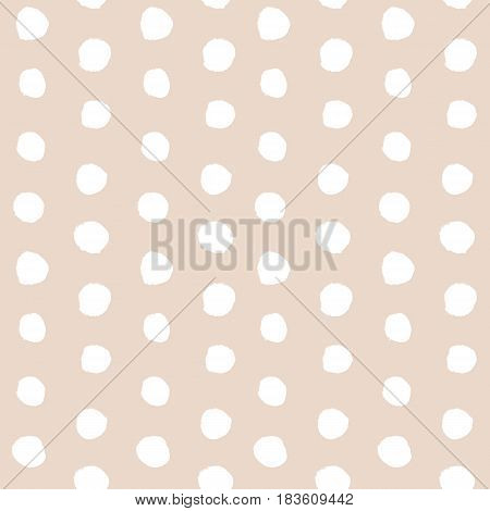 Abstract pastel beige or almond color seamless background with hand drawn white ink polka dot pattern. Vector illustration. Simple naive scandinavian design. Tender romantic pattern.