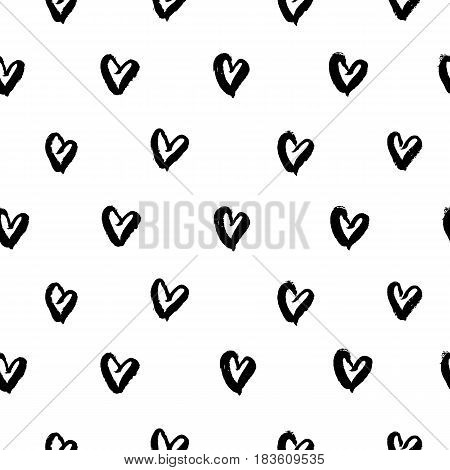 Seamless pattern with hand drawn ink black hearts. Cute black and white background. Ink brush painted scribble hearts on white background. Vector illustration.