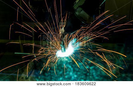 Welding robots movment  in a car factory with sparks, manufacturing, industry, factory