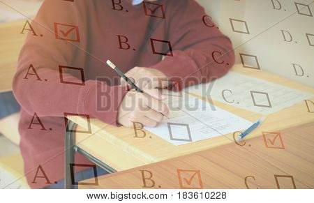 Blurred of student testing in exercise exams answer sheets or test paper with red pen : education concept