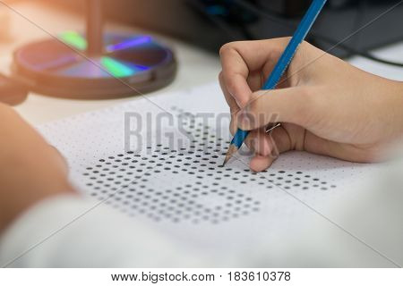 Blurred of student testing in exercise exams answer sheets or test paper with pencil : education concept