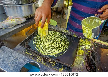 Close up of street food vendor cooking in Little India enclave in George Town, Penang, Malaysia