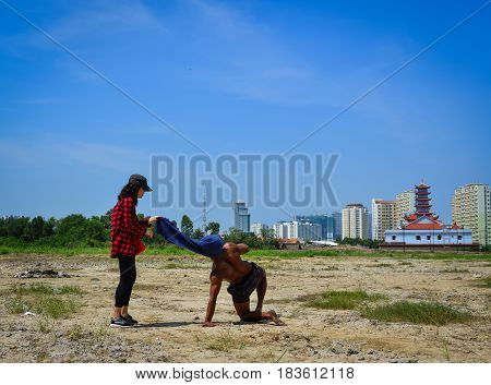 Indian Man Doing Yoga Poses At Sunny Day