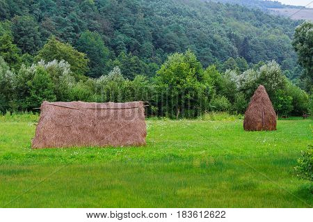 A View From The Ukrainian Carpathian Mountains, Haystacks Behind