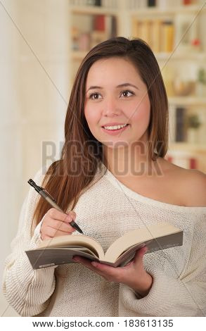 Young woman student preparing for college exams getting stressed.