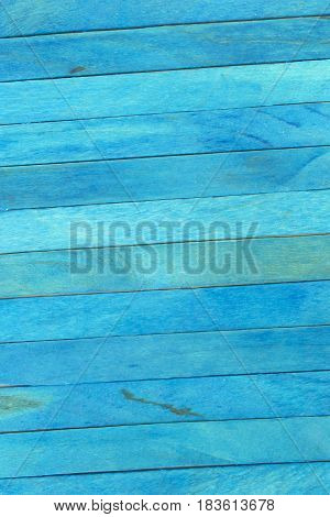 This is a photograph of Blue colored popsicle sticks background