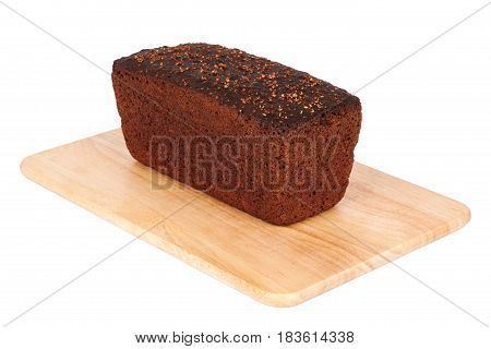 Borodinsky bread closeup. Traditional Russian rye-wheat bread with molasses malt and coriander on wooden cutting board isolated on white background