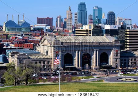 March 20, 2017 in Kansas City, MO:  Union Station where people can take Amtrak and view the historic building which is a historic city landmark with the Kansas City, MO Skyline beyond