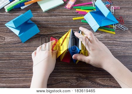 The Child Puts The Modules. The Project Of Children's Creativity Is A Children's Office Organizer Ma