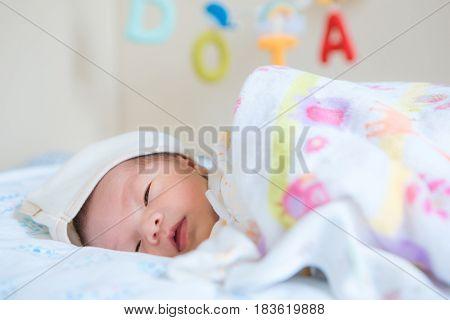 Cute Newborn asian baby asleep, close up
