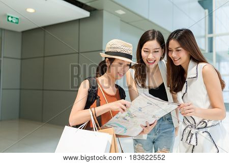 Traveler asking local people for location on map