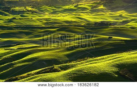 Volterra panorama rolling hills fields and meadow at sunset. Tuscany Italy Europe