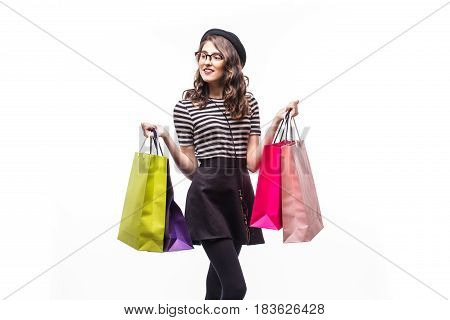 Portrait Of Young Happy Smiling Woman With Shopping Bags Isolated Over White Background
