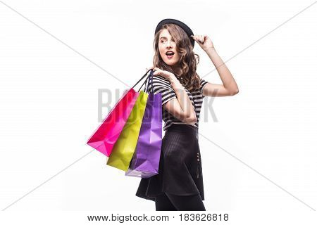 Side Portrait Of Young Happy Smiling Woman With Shopping Bags Isolated Over White Background