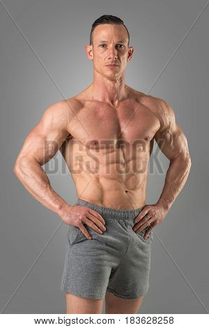 Powerful athletic man with great physique. Strong bodybuilder with six pack perfect abs shoulders biceps triceps and chest.