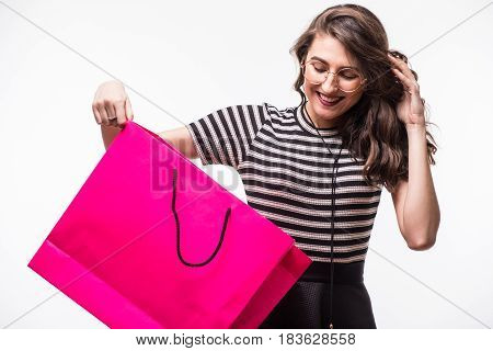 Portrait Of Beautiful Cute Happy Sweet Surprised Woman Girl Holding In Her Hands Big Shopping Bag Is